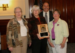 Ann Logan, Christy Belvin, and Marti Warren accept the NH Beautification Award from the NH Arborist Association for the town (May 2009)