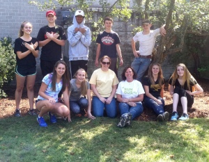 Souhegan High School students pose with their advisors in the newly weeded bed