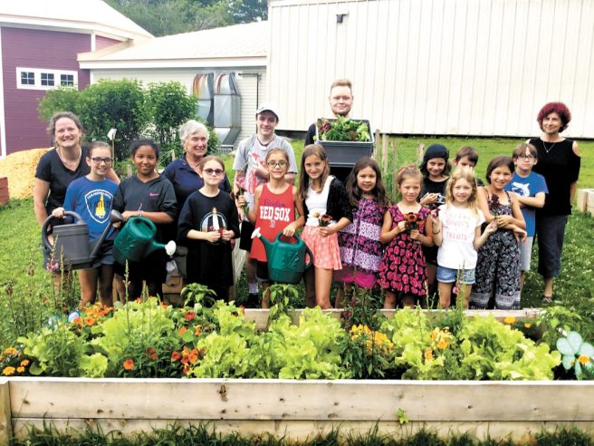 Amherst Garden Club awarded a grant to the Boys & Girls Club of Souhegan Valley for their gardening project (photo credit: Nashua Telegraph)